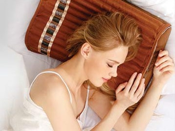 Woman with Biomat amethyst pillow